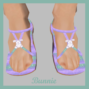 Bunnie's subtle lavender and teal print is perfect for spring. The straps are decorated with a stuffed bunny texture.